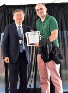 Jorge Yanez receives the NURETH best paper award from the chair of the Honors and Awards committee Chul-Hwa Song.