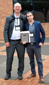 Julio Pacio and co-author Ferry Roelofs proudly show their best paper award.
